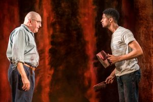 Production photo of Alfred Molina and Alfred Enoch in Red