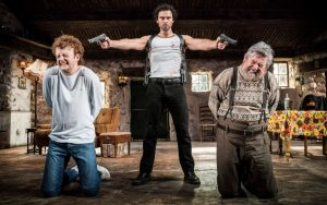 Production photo of Chris Walley, Aidan Turner and Denis Conway in The Lieutenant Of Inishmore by Martin McDonagh, directed by Michael Grandage