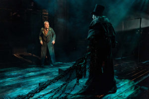 Production shot of Stephen Tompkinson as Scrooge and Michael Rouse as marley in A Christmas Carol at The Old Vic London
