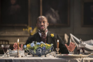 Production shot of Giles Terera in Rosmersholm at the Duke Of York's Theatre in London