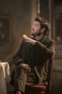 Production shot of tom Burke in Rosmersholm at Duke Of York's Theatre in London