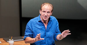 Production shot of Ralph Fiennes in David Hare's play Beat The Devil at the Bridge Theatre in London