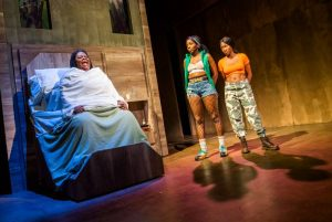 Production photo of Cecilia Noble, Tamara Lawrence and Adelayo Adedayo in Is God Is at the Royal Court theatre in London